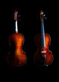 The Violin (front and back). Violin with sidelight and black background front and back royalty free stock image