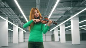 Violin is getting skillfully played by the woman. 4K stock video