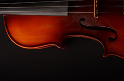 Violin. Gorgeous violin as a background close-up Royalty Free Stock Images