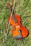 Violin on Grass Royalty Free Stock Photography