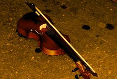 Violin in the ground Royalty Free Stock Photo