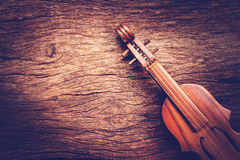 Violin on grunge dark wood background Royalty Free Stock Photo