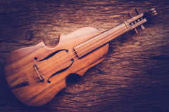 Violin on grunge dark wood background Stock Photos