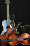 Violin guitar and accordion still life Stock Photography