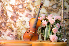 Violin,guitar,flute  and rose Stock Images