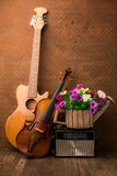 Violin, guitar and radio on still-life Stock Photos