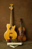 Violin and guitar in vintage style Royalty Free Stock Photography
