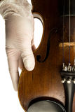 Violin hand. Classical hand surgical gloves music violin royalty free stock images