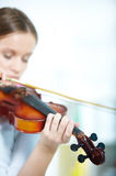 Violin in hands Royalty Free Stock Photo