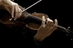 The violin in the hands of a musician closeup Stock Photography
