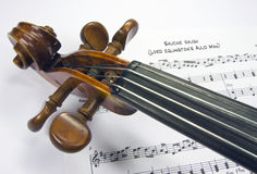 Violin head with sheet music Royalty Free Stock Images