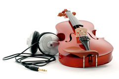 Violin and headphones Stock Photos