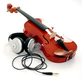 Violin and headphones Royalty Free Stock Photos