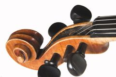 Violin headstock. Headstock of a early 18th century Jacobus Stainer Fiddle isolated on white Stock Photography