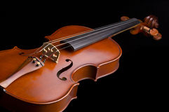Beautiful wooden vintage violin. Violin isolated on black background stock photography