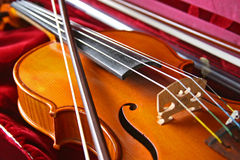 Violin in its case. Violin laying in its red case Royalty Free Stock Photography