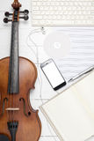 Violin with keyboard computer music paper note dvd disc and smar. T phone on white wood background Stock Image
