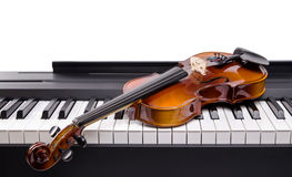 Violin on the keys digital piano close-up Royalty Free Stock Images