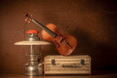 Violin with lantern on old steel background Royalty Free Stock Photos