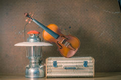 Violin with lantern on old steel background Royalty Free Stock Images