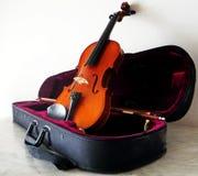 Violin on its black case Stock Photos