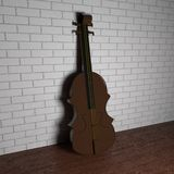Violin leaning over wall Stock Photography