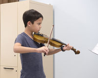 A violin lesson Royalty Free Stock Photo