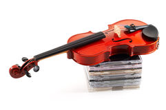 Violin lying down on CDs on wh Stock Photography