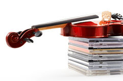 Violin lying down on CDs on wh Stock Photos