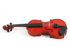 Violin lying down on white bac Stock Photos