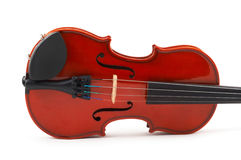 Violin lying side down on whit Royalty Free Stock Photo
