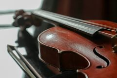 Violin lying on a smooth surface. stock photography