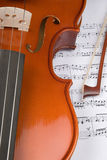 Violin Music. Closeup of violin with bow and sheet music Royalty Free Stock Photo