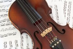 Violin on Music. Violin on bed of sheet music stock image