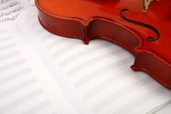 Violin on music book Stock Image
