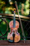 Violin music instrument of orchestra. Violins in the park on the bench.  Royalty Free Stock Image