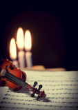 Violin, music notes and candles Royalty Free Stock Image