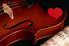 Violin, music notes and red hearts royalty free stock photo