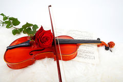 Violin with music and red rose Royalty Free Stock Photography