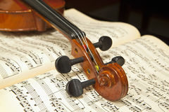 Violin on Music Sheet. Violin Tuning Peg on Music Notes Sheet Stock Images
