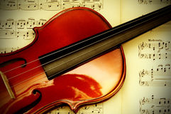 Violin with music sheet. Detail of a classical violin on a music sheet with vignette effect Royalty Free Stock Photo