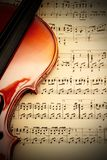 Violin with music sheet. Detail of a classical violin on a music sheet with vignette effect Royalty Free Stock Images