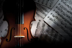 Violin on Music Sheets Royalty Free Stock Photo