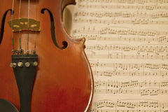 Violin with Music Sheets. Musical Notes as Background Royalty Free Stock Image