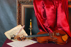 Violin and music sheets Stock Image