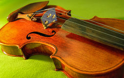 Violin, musical instrument. Lying on green velvet, no people Stock Photos