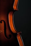 Violin musical instruments of orchestra closeup on black Stock Images
