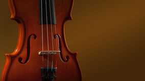 Violin musical instruments of orchestra closeup on black Royalty Free Stock Image