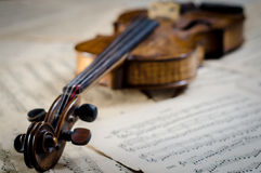 Violin on musical sheets Stock Photo