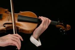 Violin musician. Violin close up on black Royalty Free Stock Photography